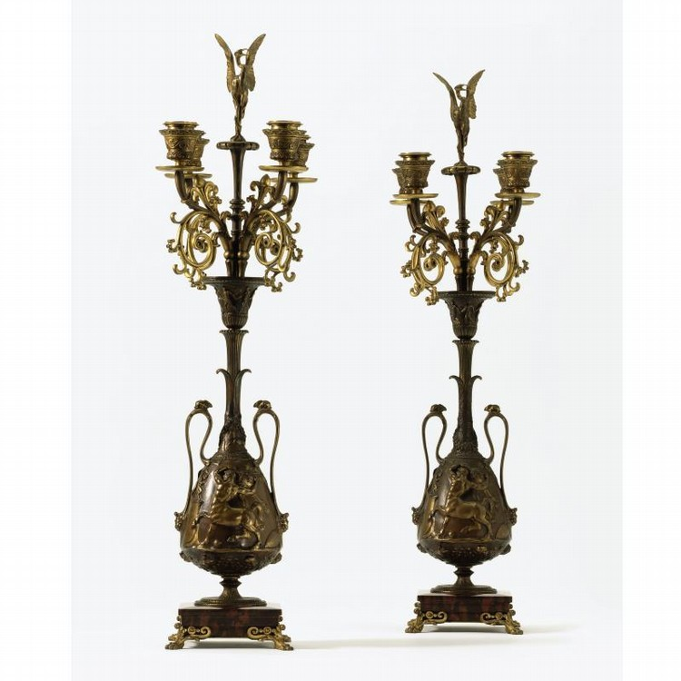 A PAIR OF NAPOLEON III ROUGE GRIOTTE MARBLE AND PATINATED BRONZE FOUR-LIGHT CANDELABRA