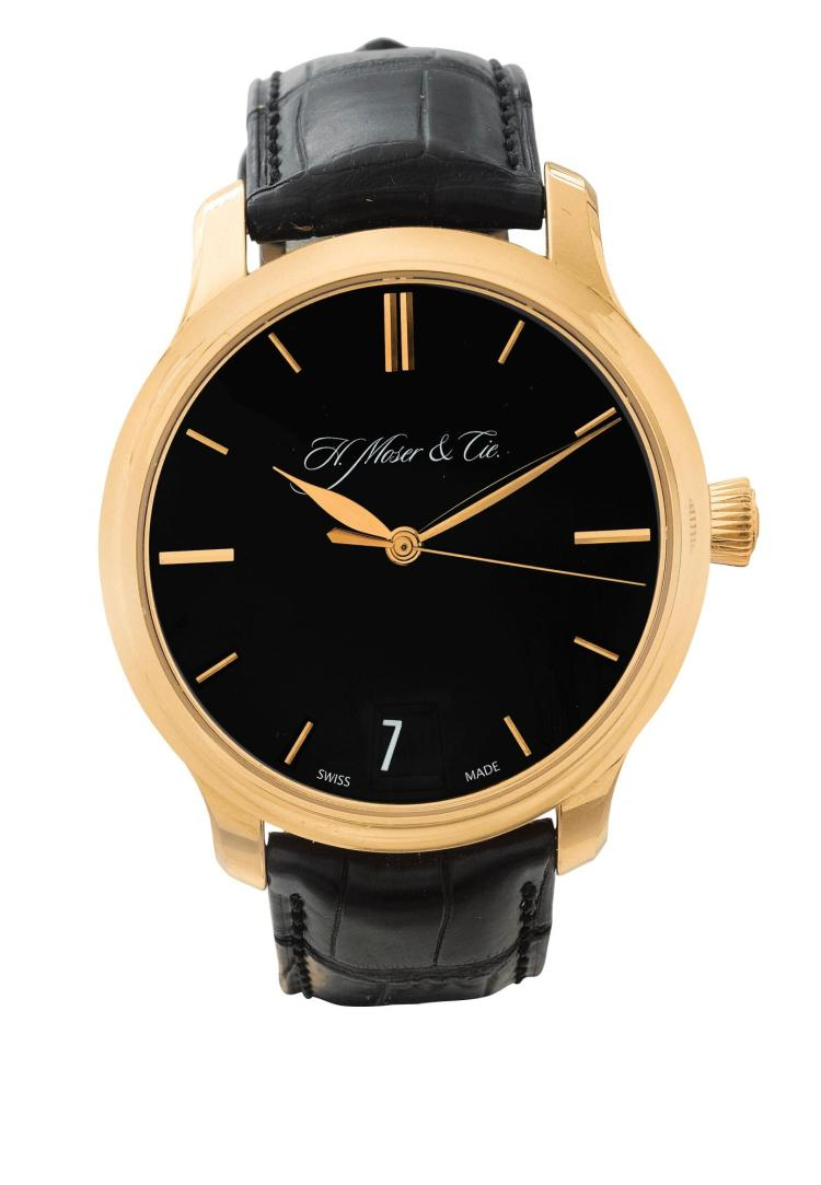 H. MOSER & CIE | A PINK GOLD WRISTWATCH WITH DATE AND POWER RESERVE INDICATION CASE 100456 NO 200 CIRCA 2011