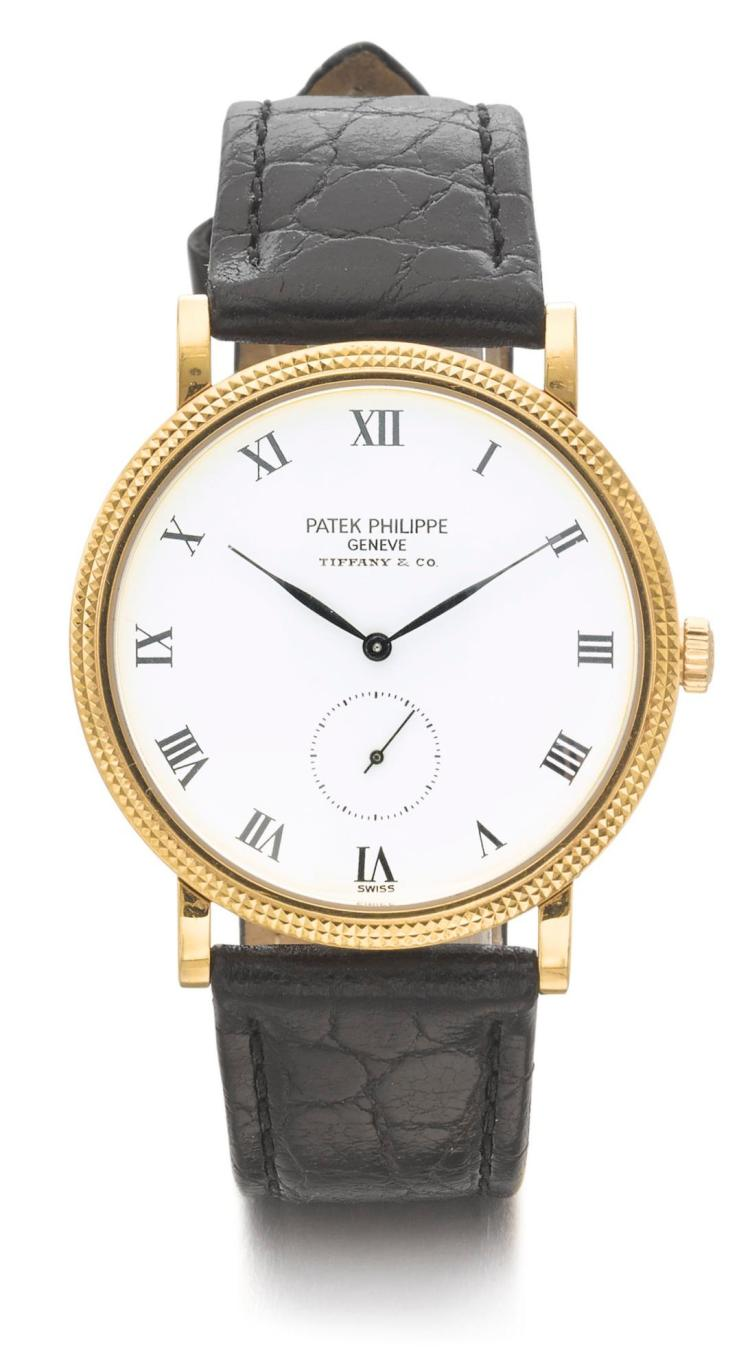 PATEK PHILIPPE | RETAILED BY TIFFANY & CO.: A YELLOW GOLD WRISTWATCH MVT 3919 MVT 1871103 CASE 4103283 MADE IN 1999