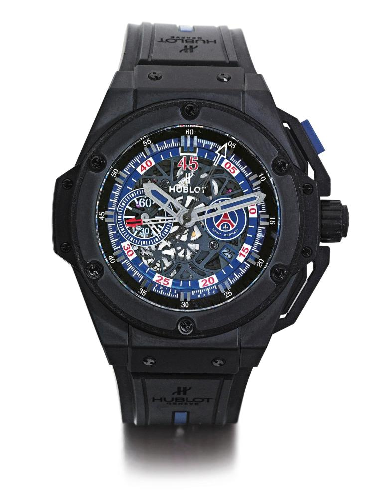 HUBLOT | A LIMITED EDITION BLACKENED CERAMIC AND TITANIUM AUTOMATIC CHRONOGRAPH WRISTWATCH WITH DATE AND REGISTERS CASE 988250 NO 095/200 KING POWER PARIS SAINT GERMAIN CIRCA 2014