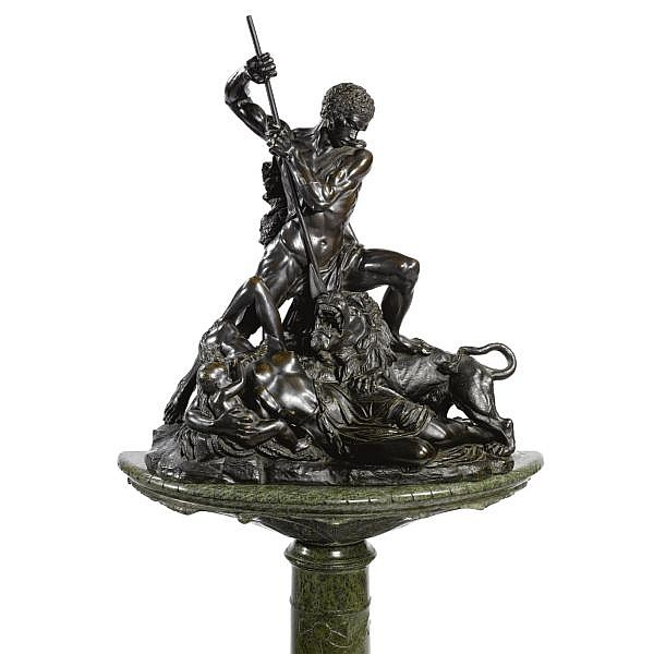 Jan-Jozef Jaquet , Belgian 1822-1898 A Nubian defending his family against a lion bronze, dark brown patina , raised on a green marble pedestal decorated with a carved flower garland
