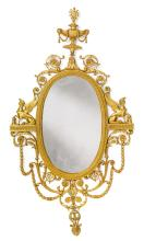EDWARD F. CALDWELL & CO<BR>1851-1914<BR>A GILT-BRONZE MIRROR<BR>NEW YORK, EARLY 20TH CENTURY, AFTER A DESIGN BY ROBERT AND JAMES ADAM |