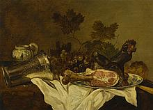 ABRAHAM SUSENIER   Still life with a ham on a wan-li kraak dish, a fallen silver beaker, a mustard jar and grapes, all on a table draped with a white cloth