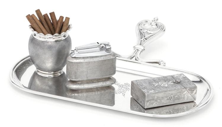 AN ITALIAN SILVER TABLE LIGHTER, CIGAR HOLDER, AND SNUFFERS TRAY, BUCCELLATI, MILAN, 20TH CENTURY |