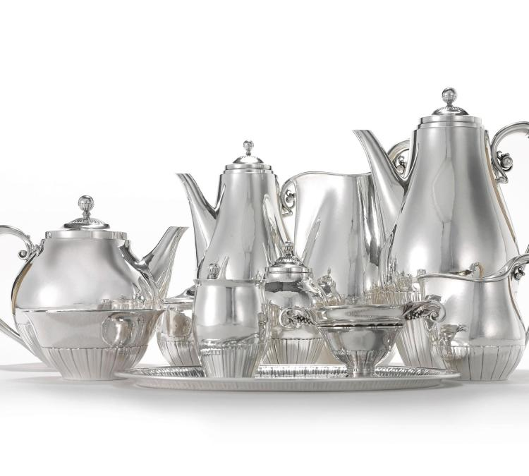 A DANISH SILVER COSMOS PATTERN TEA AND COFFEE SERVICE #45, DESIGNED BY JOHAN ROHDE, GEORG JENSEN SILVERSMITHY, COPENHAGEN, 20TH CENTURY |