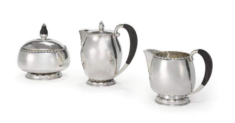 A DANISH SILVER COVERED JUG #36 AND CREAMER AND COVERED SUGAR BOWL #34, DESIGNED BY GEORG JENSEN, GEORG JENSEN SILVERSMITHY, COPENHAGEN, 1945-77 |