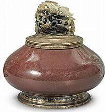 AN EDWARD I. FARMERSTERLING SILVER-MOUNTED COPPER-RED GLAZED INKWELL WITH JADE FINIAL<BR>THE PORCELAIN 19TH CENTURY<BR />THE SILVER MOUNTS EARLY 20TH CENTURY<BR />THE JADE YUAN / MING DYNASTY  