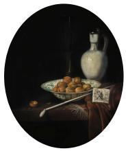 HUBERT VAN RAVESTEYN   Still life of walnuts in a Wan-Li porcelain bowl, a glazed earthenware jug, and a pipe and smoking materials on a partly draped table