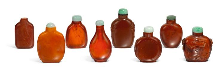 A STUDY GROUP OF EIGHT AMBER SNUFF BOTTLES QING DYNASTY |