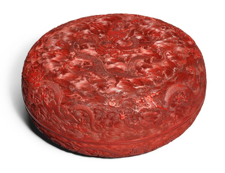 A LARGE AND IMPRESSIVE CINNABAR LACQUER 'NINE DRAGON' BOX AND COVER QING DYNASTY, QIANLONG PERIOD |