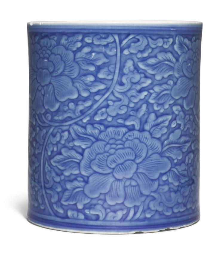 A BLUE-GLAZED 'PEONY SCROLL' BRUSHPOT QING DYNASTY, KANGXI PERIOD |