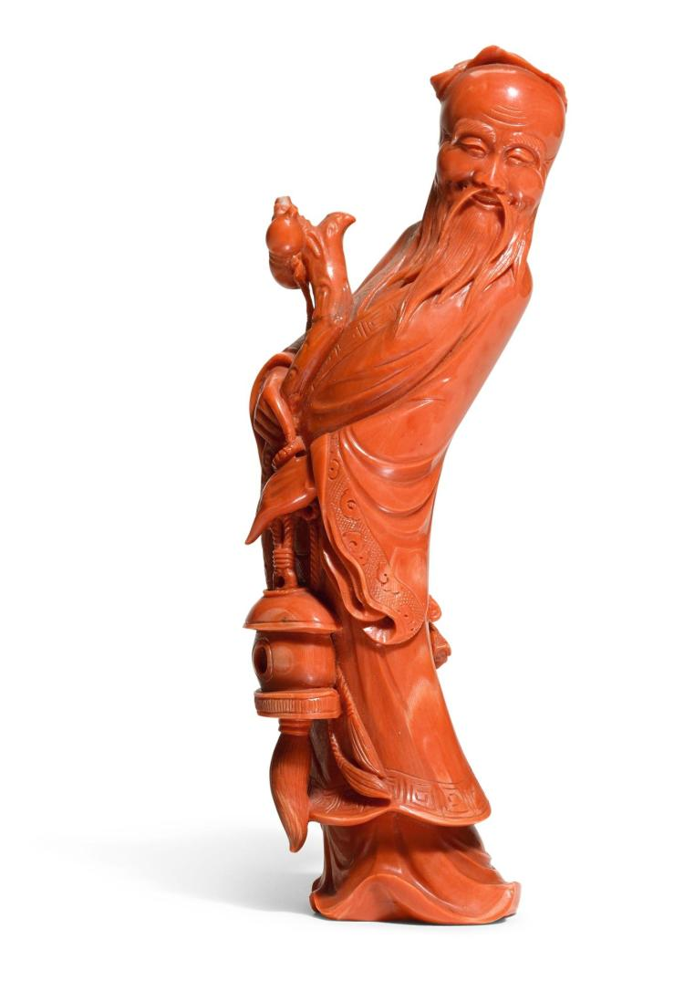 A CARVED CORAL FIGURE OF SHOULAO 20TH CENTURY |