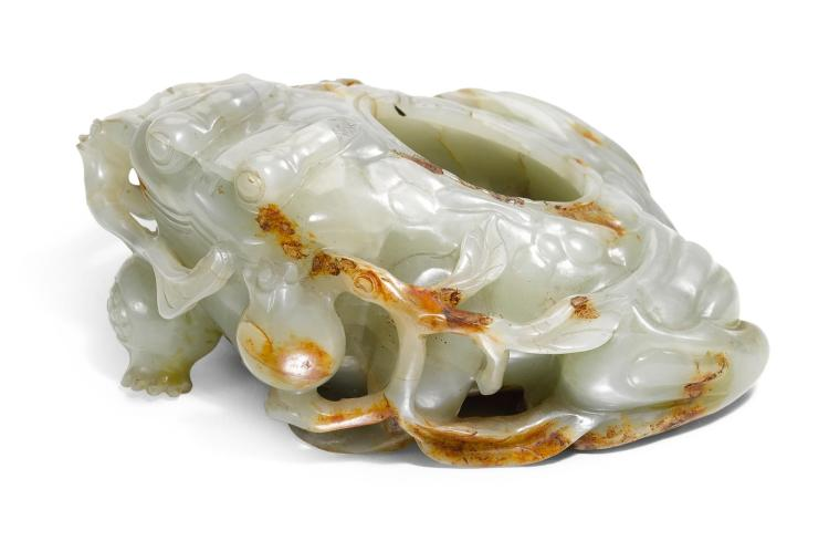 A CELADON AND RUSSET JADE'TOAD' WATERPOT QING DYNASTY, 19TH CENTURY |
