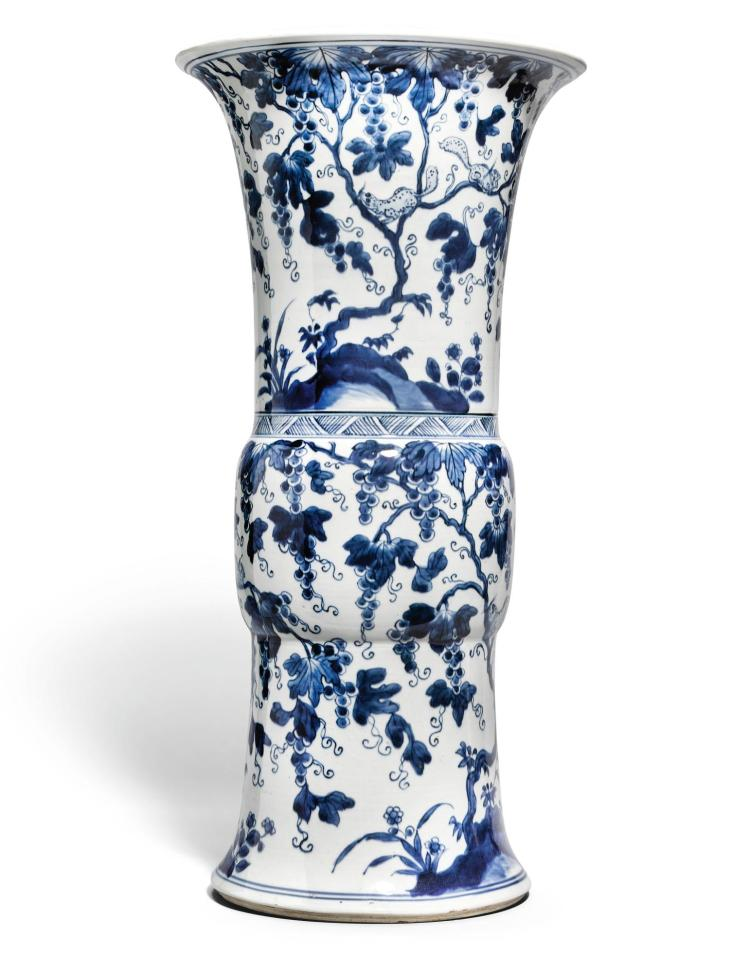 A LARGE BLUE AND WHITE 'SQUIRREL AND GRAPEVINE' BEAKER VASE QING DYNASTY, 18TH CENTURY |