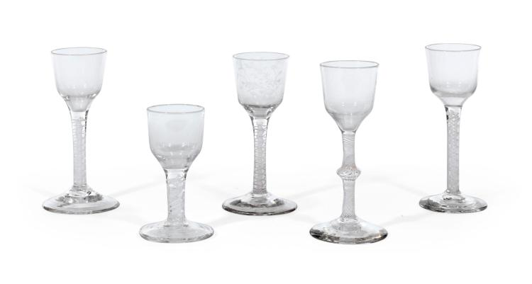 A GROUP OF FIVE OPAQUE-TWIST WINE GLASSES, CIRCA 1765  