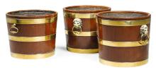 A PAIR OF REGENCY BRASS MOUNTED COOPERED MAHOGANY WINE COOLERS  