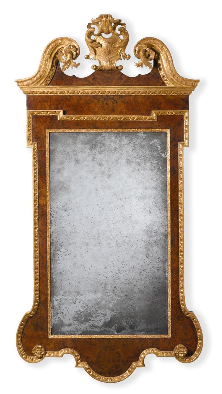 A GEORGE II PARCEL-GILT AND BURR WALNUT MIRROR |