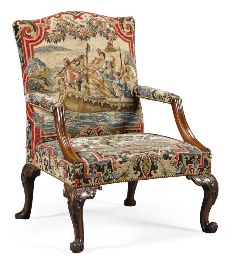 A GEORGE II CARVED MAHOGANY GAINSBOROUGH ARMCHAIR, CIRCA 1750, IN THE MANNER OF MATTHIAS LOCK |