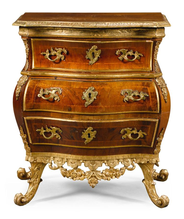 A DANISH ROCOCO GILT-BRONZE MOUNTED WALNUT AND CARVED GILTWOOD BOMBE COMMODE ATTRIBUTED TO MATTHIAS ORTMANN, COPENHAGEN CIRCA 1760 |