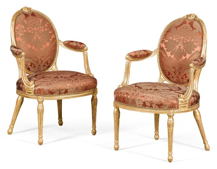A PAIR OF GEORGE III GILTWOOD ARMCHAIRS, CIRCA 1770, ATTRIBUTED TO WILLIAM & JOHN LINNELL |
