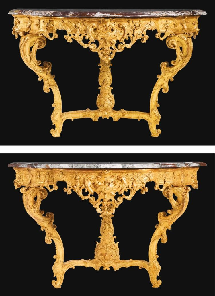 A NEAR PAIR OF LOUIS XV CARVED GILTWOOD CONSOLE TABLES, IN THE MANNER OF FRANÇOIS ROUMIER CIRCA 1730 |