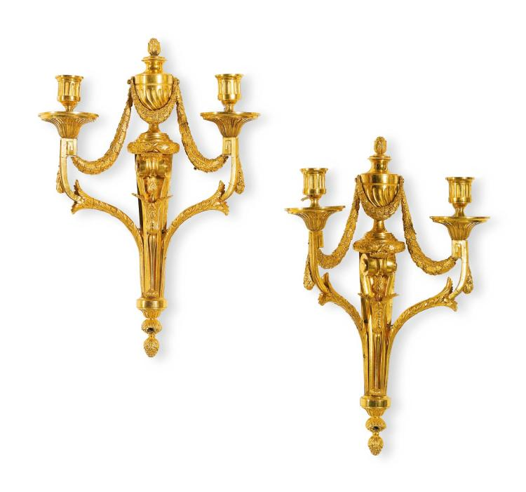 A PAIR OF TRANSITIONAL GILT-BRONZE WALL LIGHTS IN THE MANNER OF QUENTIN-CLAUDE PITOIN AFTER A DESIGN BY JEAN-CHARLES DELAFOSSE LOUIS XVI, CIRCA 1770 |