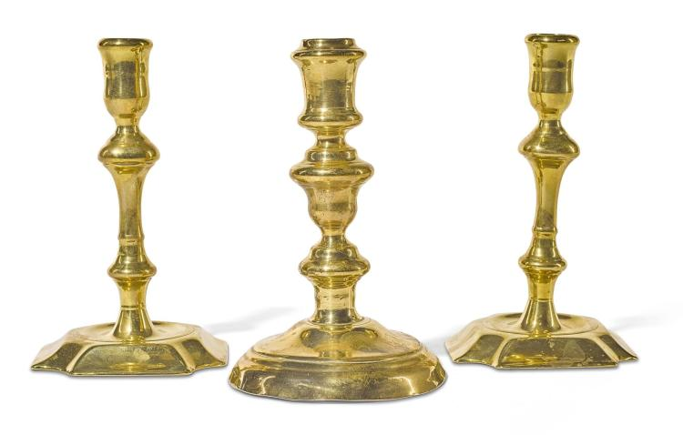 A PAIR OF GEORGE II BRASS CANDLESTICKS, MID 18TH CENTURY |
