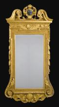 A GEORGE II CARVED GILTWOOD AND GESSO MIRROR, CIRCA 1735 |