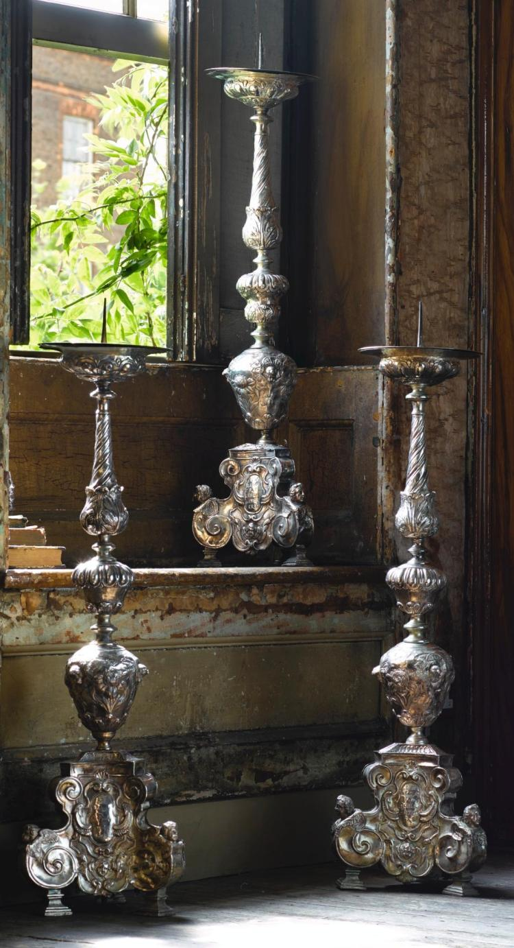 A SET OF THREE GERMAN REPOUSSÉ SILVERED COPPER ALTARSTICKS LATE 17TH CENTURY |