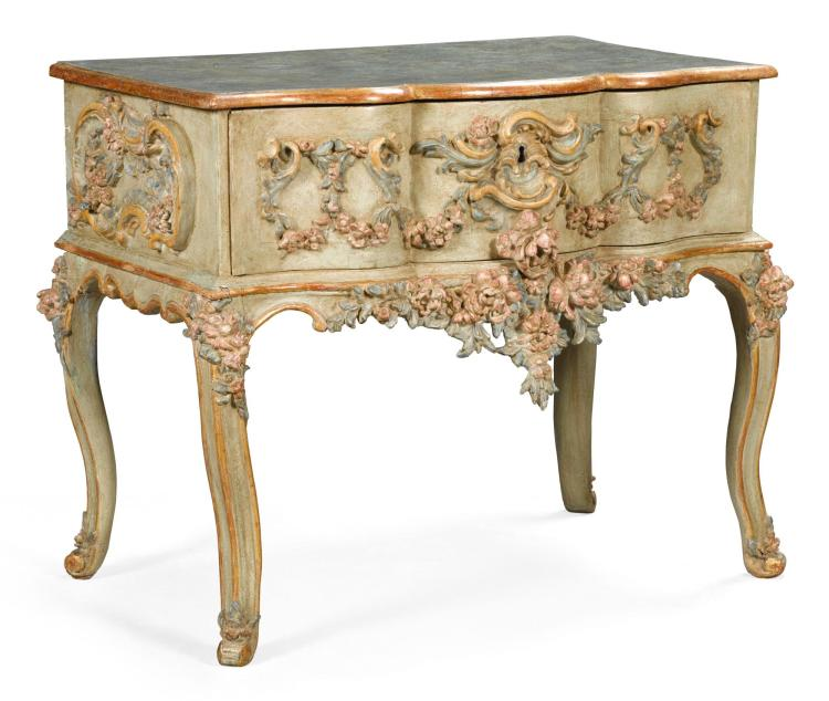 AN ITALIAN CARVED PAINTED AND PARCEL-GILT COMMODE 18TH/19TH CENTURY |