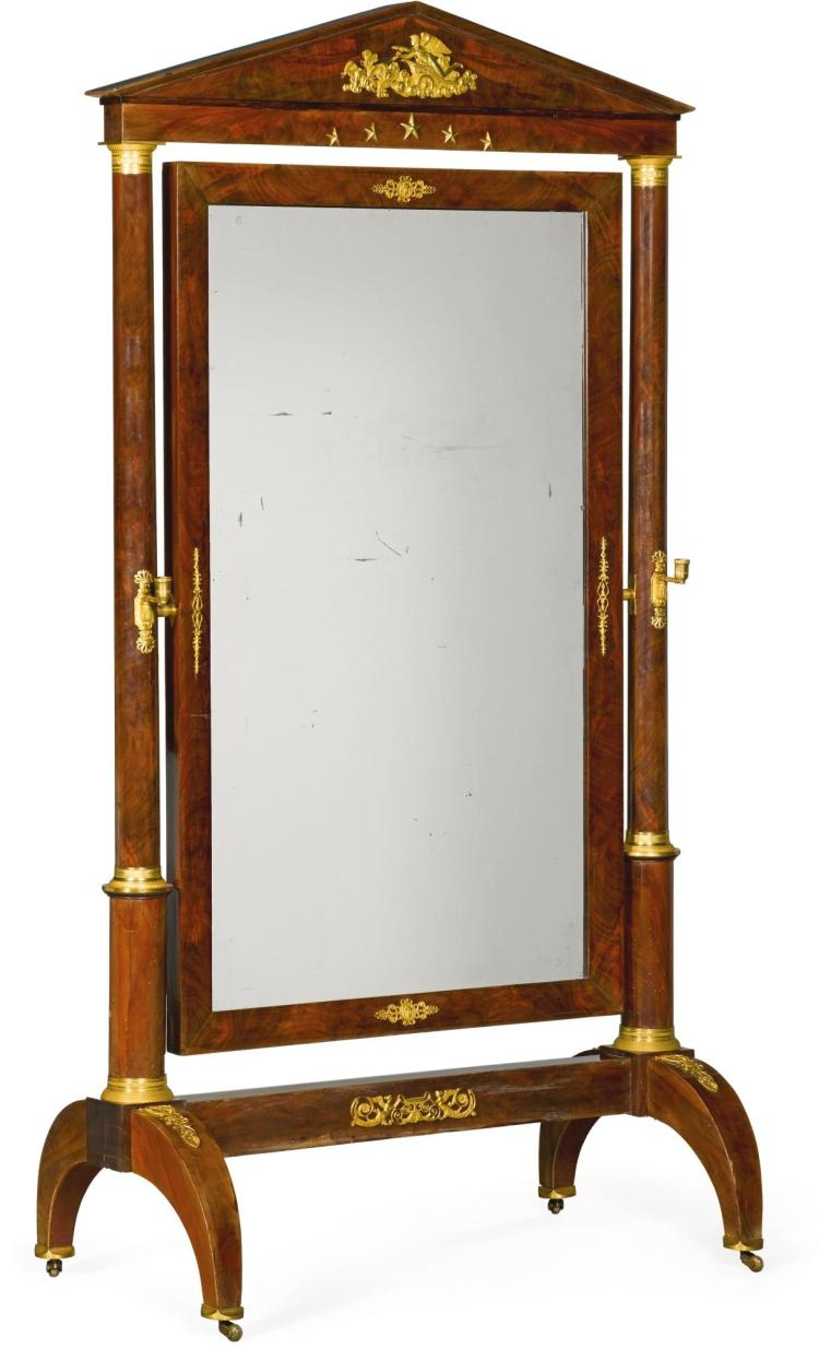 AN EMPIRE GILT-BRONZE MOUNTED MAHOGANY CHEVAL MIRROR CIRCA 1820 |
