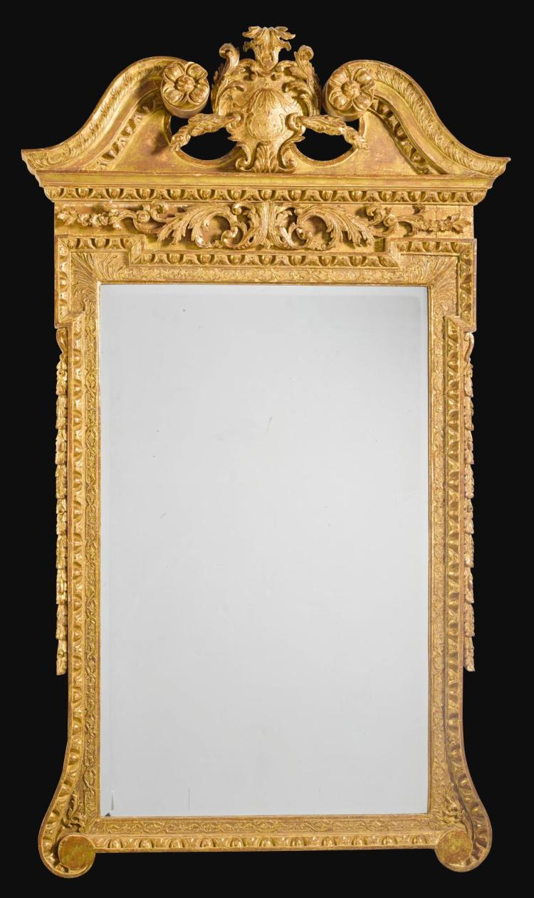 A GEORGE II CARVED GILTWOOD MIRROR, CIRCA 1730 |