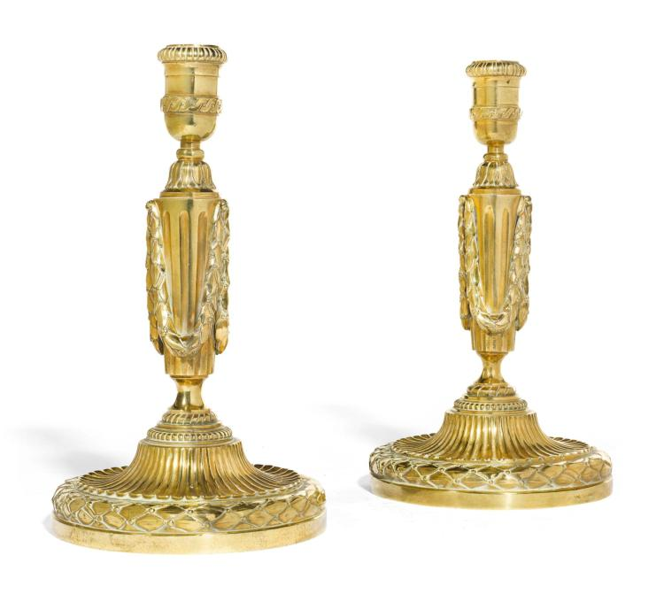 A PAIR OF LOUIS XVI STYLE GILT-BRASS CANDLESTICKS, LATE 19TH/EARLY 20TH CENTURY |