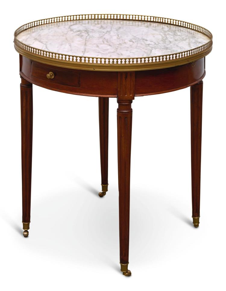 A LOUIS XVI STYLE BRASS MOUNTED MAHOGANY BOUILLOTTE TABLE |