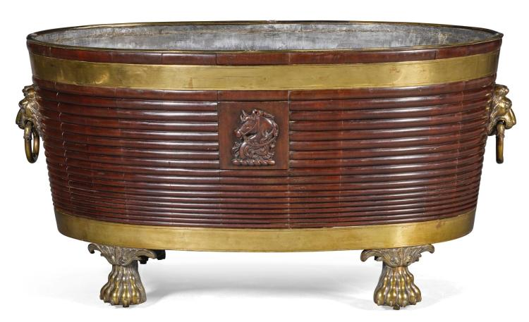 A LARGE IRISH REGENCY STYLE BRASS BOUND MAHOGANY WINE COOLER |