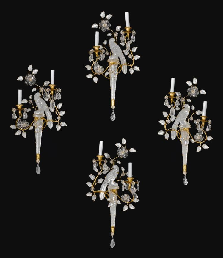 A SET OF FOUR GILT-METAL AND CUT GLASS TWO-LIGHTAPPLIQUES, IN THE MANNER OF MAISON BAGUES 20TH CENTURY |