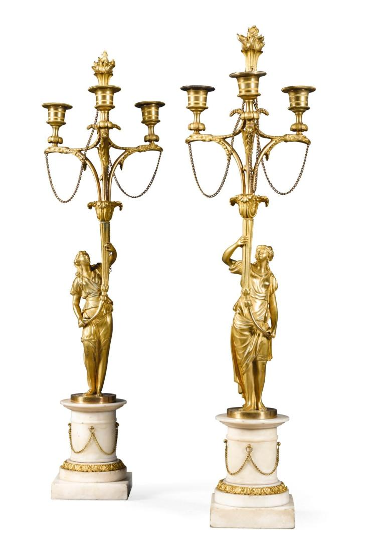 A PAIR OF GILT-BRONZE AND WHITE MARBLE THREE LIGHT CANDELABRA |