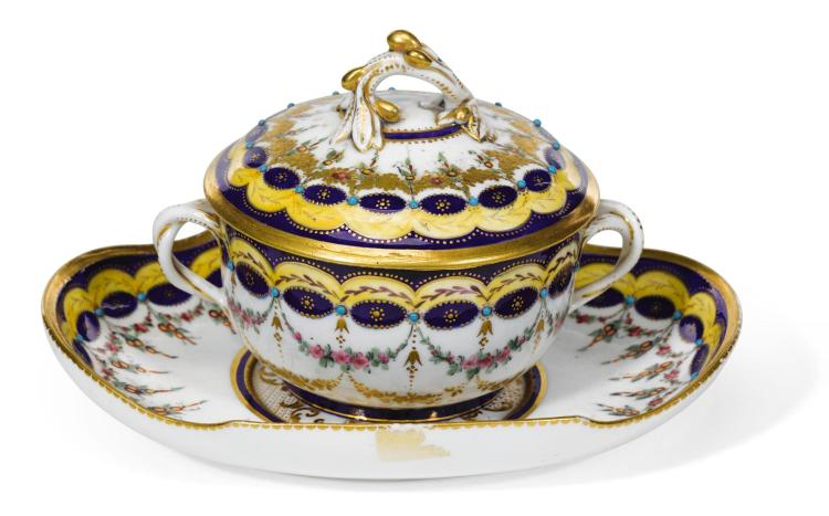 A SMALL SÈVRES-STYLE TWO-HANDLED ÉCUELLE, COVER AND STAND, THE PORCELAIN 18TH CENTURY, THE DECORATION LATER |