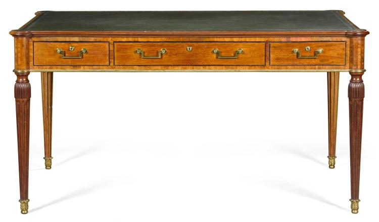 A GEORGE III GILT-BRASS MOUNTED AND EBONY STRUNG MAHOGANY WRITING TABLE,  CIRCA 1800, IN THE MANNER OF GILLOWS |