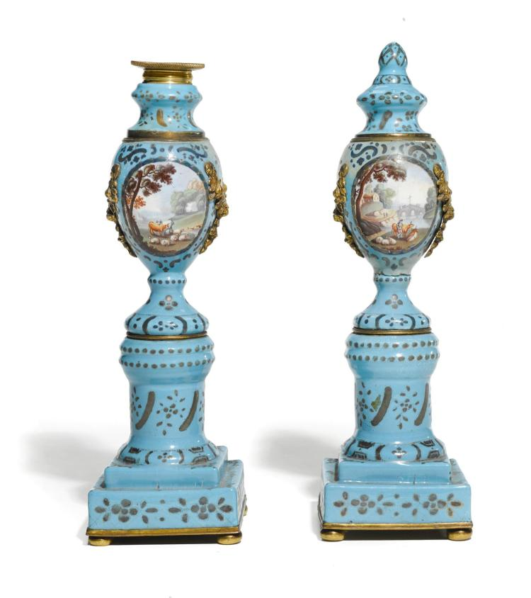 A PAIR OF STAFFORDSHIRE ENAMEL REVERSIBLE CANDLESTICKS, CIRCA 1780 | A pair of Staffordshire enamel reversible candlesticks, circa 1780