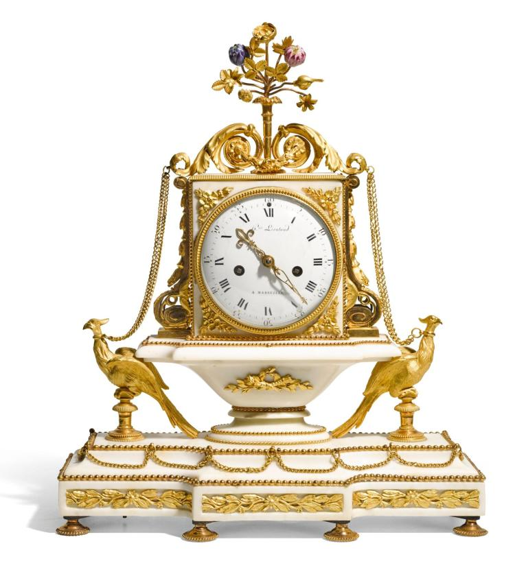 A LOUIS XVI WHITE MARBLE, ORMOLU AND PORCELAIN MANTEL CLOCK, BY HONORÉ LIEUTAUD, MARSEILLES, CIRCA 1785 |