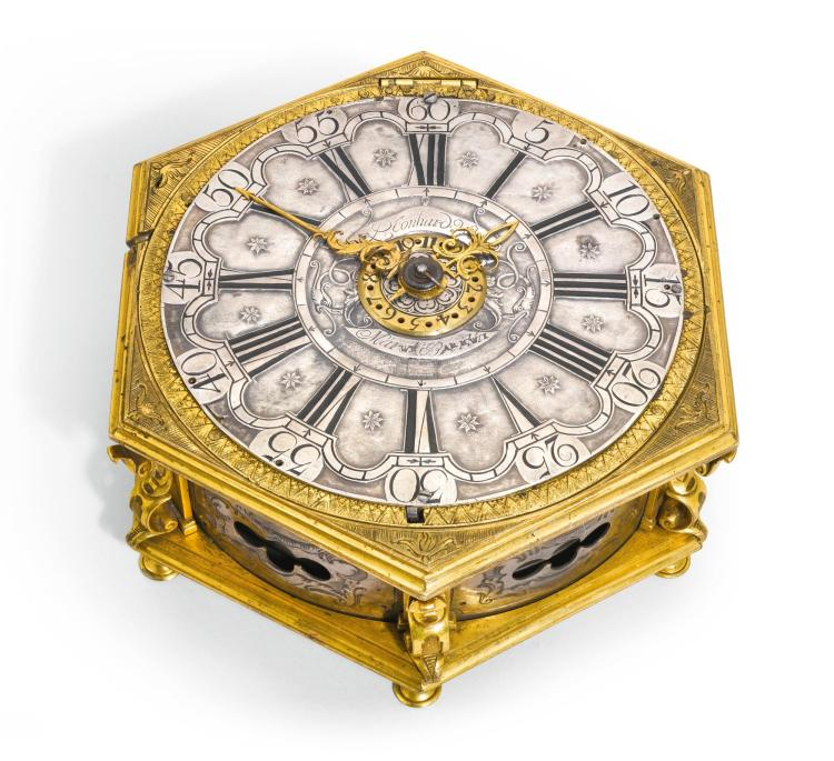 A GILT-BRASS HEXAGONAL QUARTER STRIKING TABLE CLOCK WITH ALARM, GERMAN, CIRCA 1700 AND LATER |