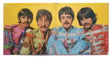 THE BEATLES — JOHN LENNON. SGT. PEPPER'S LONELY HEARTS CLUB BAND SIGNED ALBUM SLEEVE, 1967