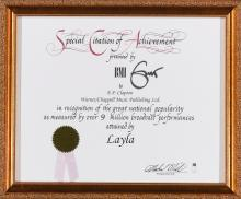 ERIC CLAPTON. A SPECIAL CITATION OF ACHIEVEMENT CERTIFICATE PRESENTED BY THE BMI TO ERIC CLAPTON