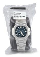 PATEK PHILIPPE | A STAINLESS STEEL AUTOMATIC WRISTWATCH WITH DATE, POWER RESERVE INDICATION, MOON-PHASES AND BRACELET, IN SINGLE FACTORY SEAL<br />REF 5712/1A MVT3172265 CASE4370318 NAUTILUS CIRCA2012