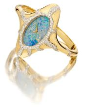 CHOPARD | AN ELEGANT AND UNUSUAL LADY'SYELLOW GOLD AND DIAMOND-SET OVAL BANGLE WATCH WITH OPAL DIAL<br>CASE 59517 CIRCA 1970<br><br>