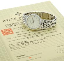 PATEK PHILIPPE | A WHITE GOLD AUTOMATIC CENTER SECONDS BRACELET WATCH WITH DATE<br />REF 3998/1G MVT 3000802 CASE 2968850 MADE IN 1995