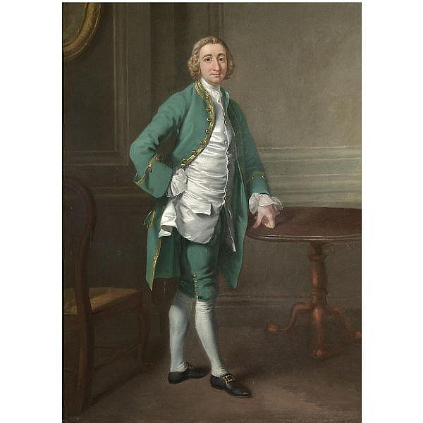 Francis Hayman R.A. , Devon circa 1708 - 1776 London Portrait of a Gentleman, possibly Mr Goodyear St. John, full length, standing by a table, wearing a green suit with a white silk waistcoat 