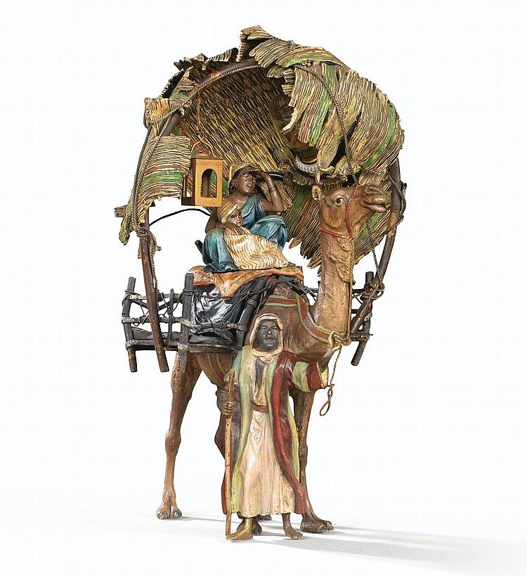 FRANZ BERGMAN, 1838-1894 BÉDOUIN MENANT SA FAMILLE SUR UN CHAMEAU | Bédouin menant sa famille sur un chameau