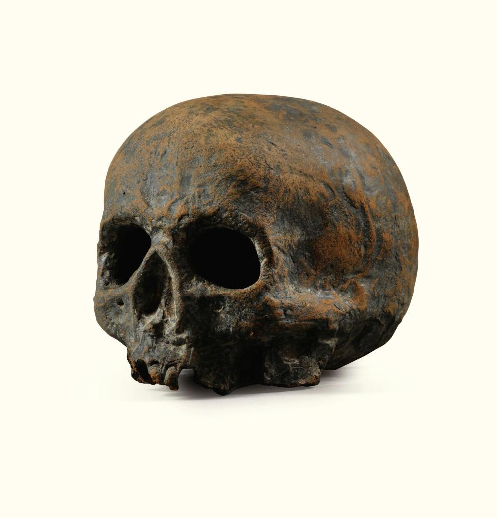 A NORTHERN EUROPE BISCUIT SKULL, LATE 18TH / EARLY 19TH CENTURY, AND A PATINATED TERRACOTTA SKULL, PROBABLY 18TH CENTURY |